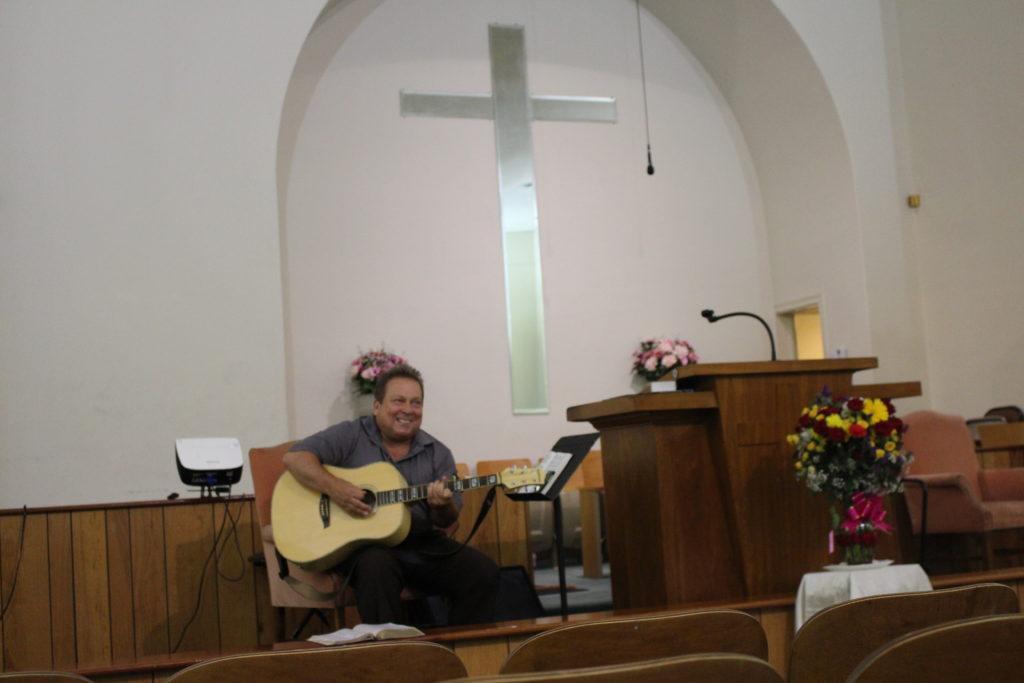 Pastor Pat playing guitar